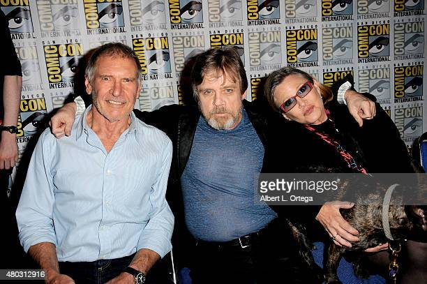 Actors Harrison Ford Mark Hamill and Carrie Fisher speak onstage at the Lucasfilm panel during ComicCon International 2015 at the San Diego...