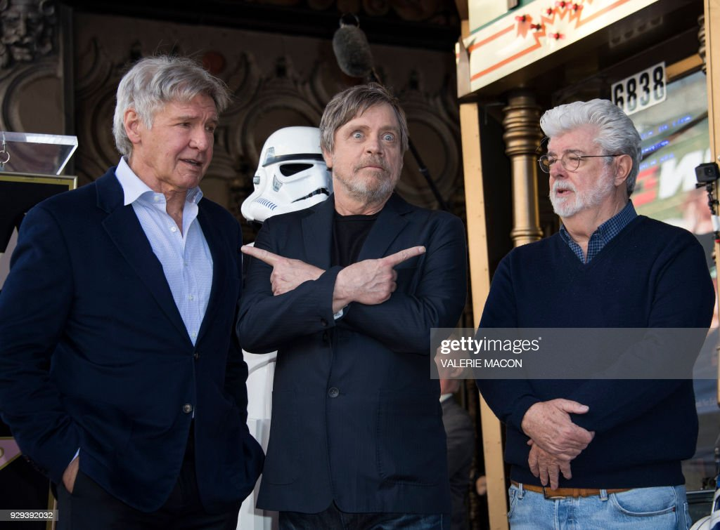 Actors Harrison Ford, Mark Hamill, and director George Lucas attend the ceremony honoring Mark Hamill with a star on the Hollywood Walk of Fame on March 8, 2018, in Hollywood, California. /