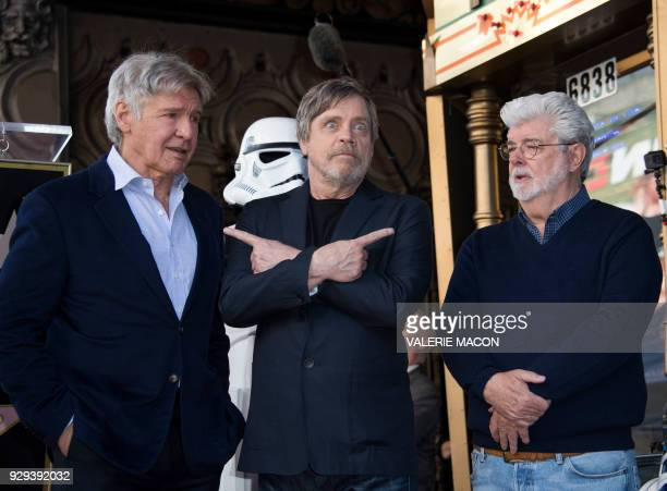 Actors Harrison Ford Mark Hamill and director George Lucas attend the ceremony honoring Mark Hamill with a star on the Hollywood Walk of Fame on...