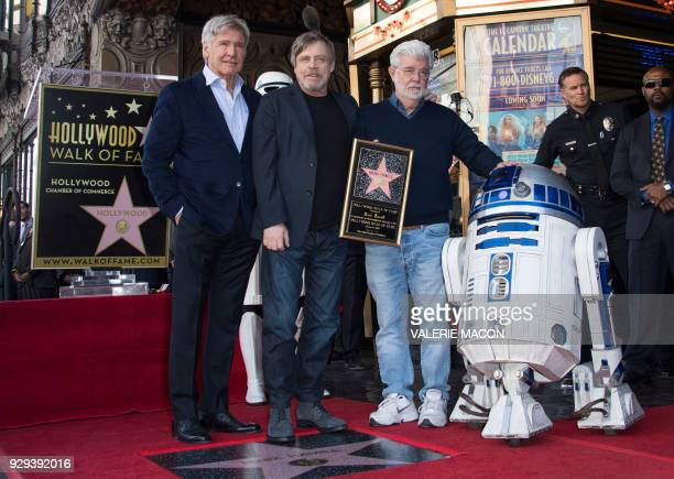 Actors Harrison Ford Mark Hamill director George Lucas and R2D2 attend the ceremony honoring Mark Hamill with a star on the Hollywood Walk of Fame on...