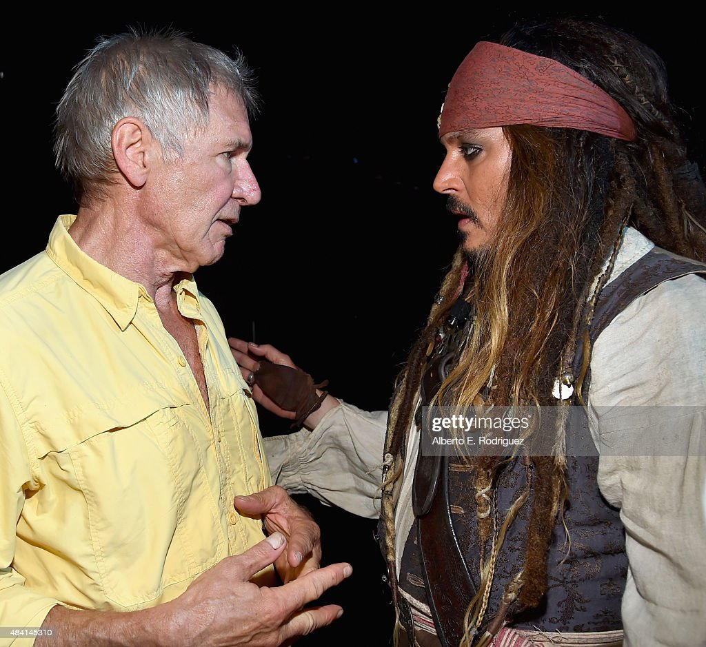 THE FORCE AWAKENS (L) and Johnny Depp, dressed as Captain Jack Sparrow, of