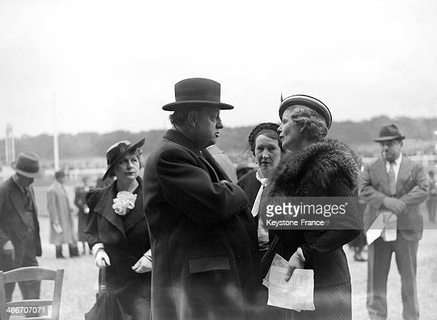 Actors Harry Baur and Elvire Popesco at Longchamp racecourse to attend the famous Prix de Diane in June 1936 in Paris France