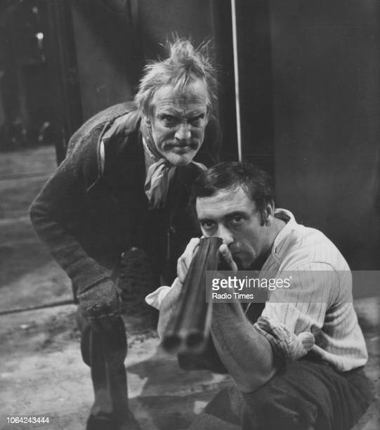 Actors Harry H Corbett and Wilfrid Brambell aiming a gun in a scene from episode 'The Siege of Steptoe Street' of the television sitcom 'Steptoe and...
