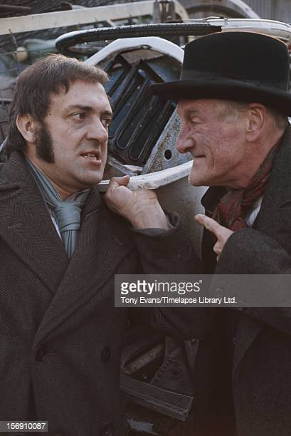 Actors Harry H Corbett and Wilfrid Brambell as they appear in the BBC sitcom 'Steptoe and Son' circa 1970