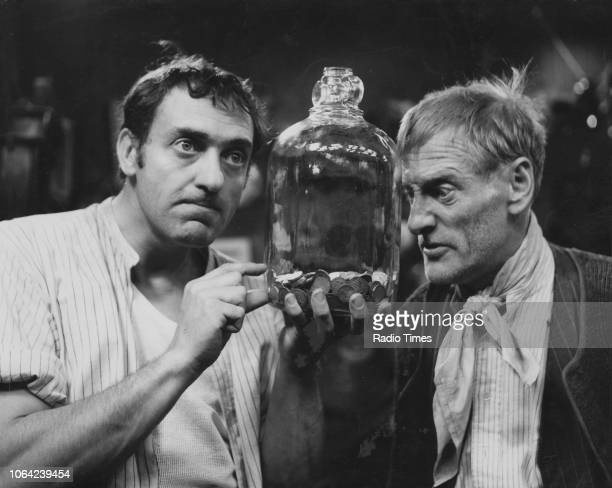 Actors Harry H Corbett and Wilfrid Brambell inspecting a money pot in a scene from episode 'WallahWallah Catsmeat' of the television sitcom the...