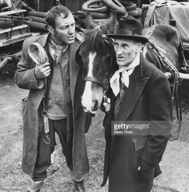 Actors Harry H Corbett and Wilfrid Brambell pictured with a horse in a scene from episode 'The Offer' of the television sitcom 'Steptoe and Son' May...