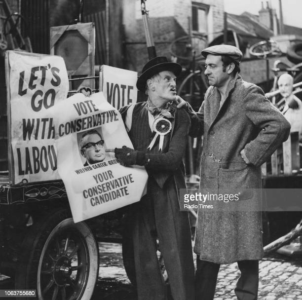 Actors Harry H Corbett and Wilfrid Brambell pictured with Conservative Party political posters in a scene from the episode 'My Old Man's a Tory' of...