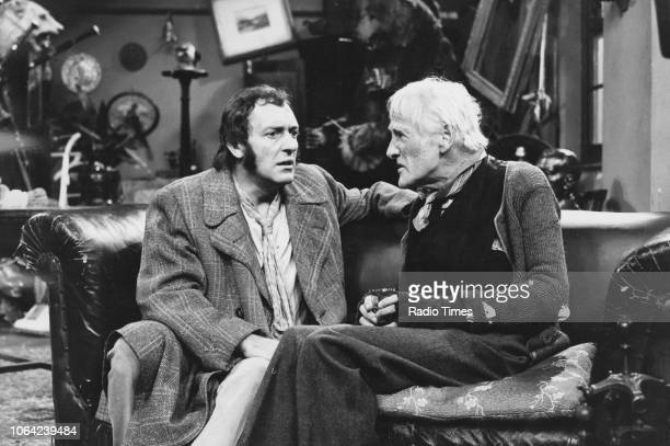 Actors Harry H Corbett and Wilfrid Brambell sitting on the sofa together in a scene from the television sitcom the 'Steptoe and Son' October 18th 1970