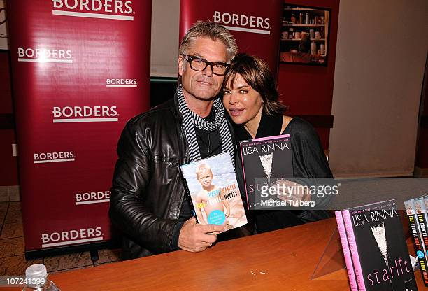 Actors Harry Hamlin and Lisa Rinna arrive at a signing event for their new books Full Frontal Nudity and Starlit on December 1 2010 in Sherman Oaks...