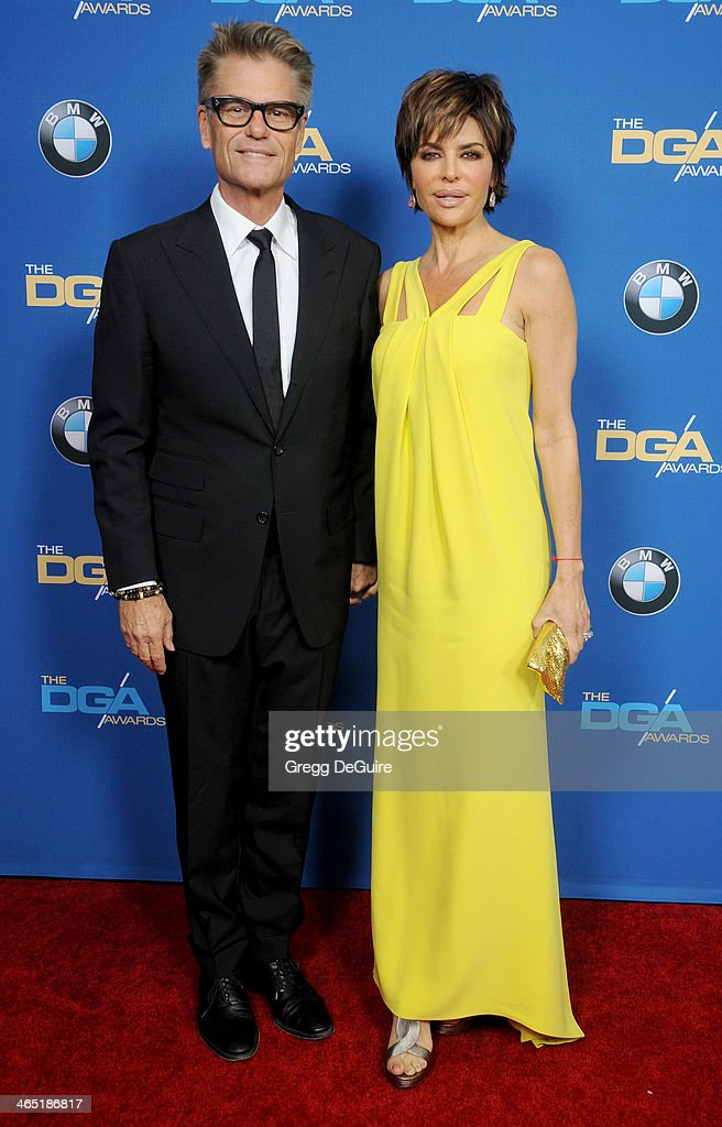 Actors Harry Hamlin and Lisa Rinna arrive at the 66th Annual Directors Guild Of America Awards at the Hyatt Regency Century Plaza on January 25, 2014 in Century City, California.