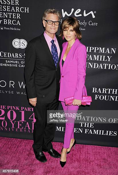 Actors Harry Hamlin and Lisa Rinna attend Elyse Walker presents the 10th anniversary Pink Party hosted by Jennifer Garner and Rachel Zoe at HANGAR 8...