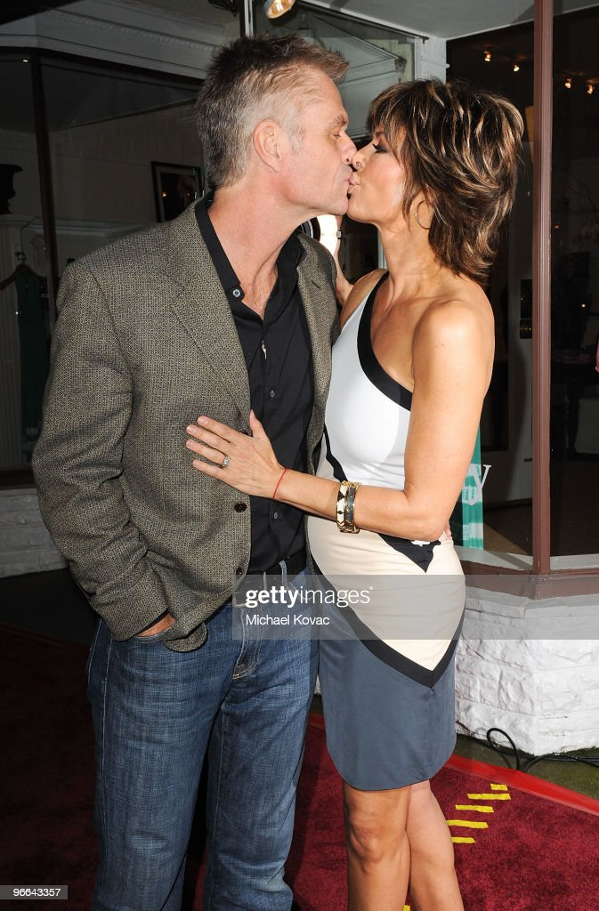 Actors Harry Hamlin (L) and Lisa Rinna celebrate the 7th anniversary of the Belle Gray Boutique on February 12, 2010 in Los Angeles, California.