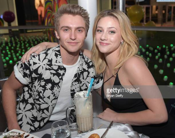 Actors Hart Denton and Lili Reinhart celebrate her cover of Ocean Drive Magazine's February issue at Sugar Factory American Brasserie at the Fashion...