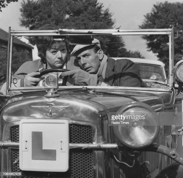 Actors Hattie Jacques and Eric Sykes driving in a car in a scene from the television sitcom episode 'Sykes and Two Birthdays' September 22nd 1964