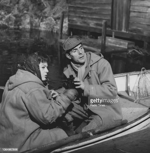 Actors Hattie Jacques and Eric Sykes sitting in a rowing boat in a scene from the television sitcom episode 'Sykes and a Log Cabin' December 10th 1963