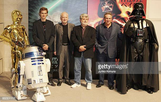C3P0 R2D2 actors Hayden Christensen Ian McDiarmid director George Lucas producer Rick McCallum and Darth Vader attend a photocall to promote the film...