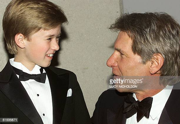 US actors Hayley Joel Osment and Harrison Ford congratulate each other backstage after winning awards at the 26th People's Choice Awards in Pasadena...