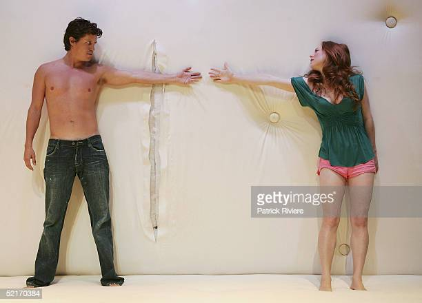 Actors Hayley McElhinney and Dan Wyllie perform during the photo call of Bed at Sydney Theatre Company's Wharf 2 Blueprints February 10 2005 in...