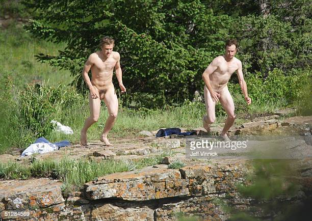 Actors Heath Ledger and a stunt double for Jake Gyllenhaal jump off a cliff 30 feet into the Bow River during filming of Brokeback Mountain July 5...