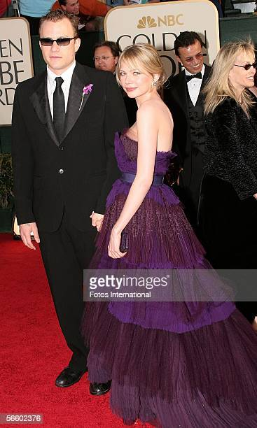 Actors Heath Ledger and Michelle Williams arrive to the 63rd Annual Golden Globe Awards at the Beverly Hilton on January 16 2006 in Beverly Hills...