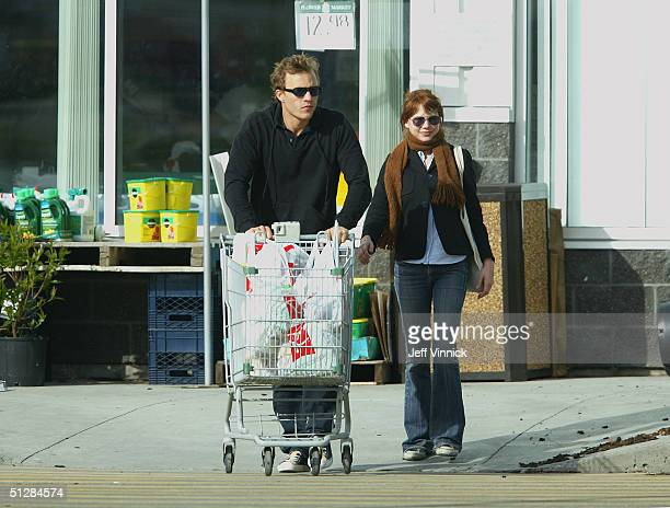 Actors Heath Ledger and Michelle Williams shop for groceries together while on a break during filming of Brokeback Mountain May 30 2004 in Fort...