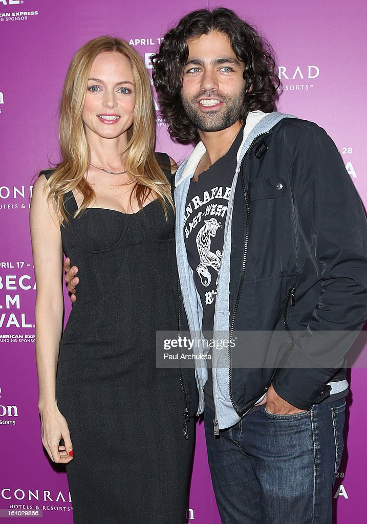 Actors Heather Graham (L) and Adrian Grenier (R) attend the 5th annual Tribeca Film Festival 2013 LA reception at The Beverly Hilton Hotel on March 18, 2013 in Beverly Hills, California.