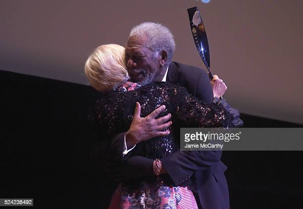 Actors Helen Mirren and Morgan Freeman embrace onstage at the 43rd Chaplin Award Gala on April 25 2016 in New York City
