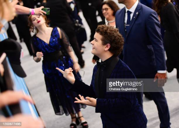 Actors Helena Bonham Carter and Gaten Matarazzo attend the 26th annual Screen ActorsGuild Awards at The Shrine Auditorium on January 19, 2020 in Los...