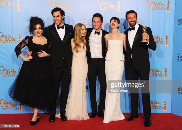 Actors Helena Bonham Carter Sacha Baron Cohen Amanda Seyfried Eddie Redmayne Anne Hathaway and Hugh Jackman of Les Miserables pose in the press room...
