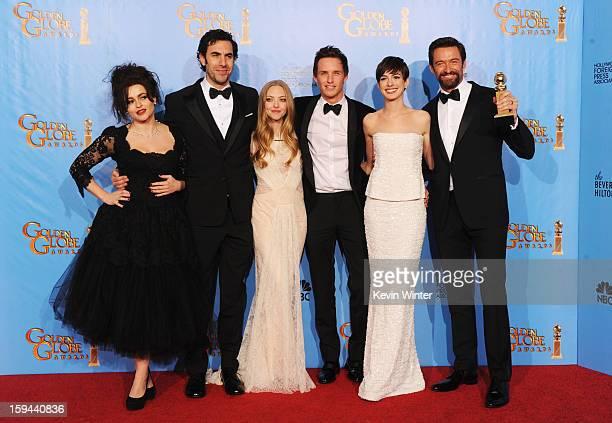 Actors Helena Bonham Carter Sacha Baron Cohen Amanda Seyfried Eddie Redmayne Anne Hathaway and Hugh Jackman of Les Miserables pose in the press room...