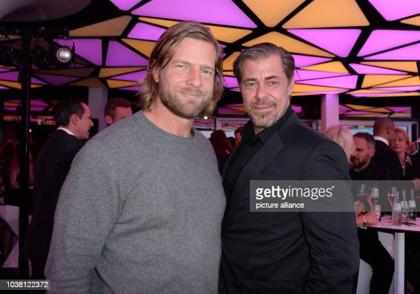 Actors Henning Baum and Sven Martinek pose during the opening party of the fitness studio 'World of Cyberobics' in Berlin, Germany, 14 April 2016....