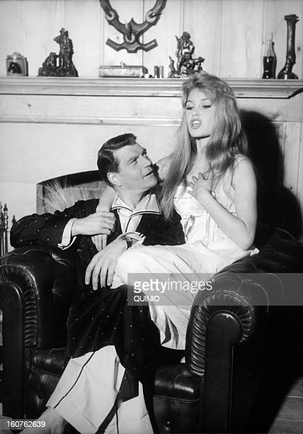 Actors Henri Vidal and Brigitte Bardot on the set of movie 'Une Parisienne' directed by Michel Boisrond in 1957 in France