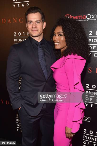 "Actors Henry Cavill and Angela Bassett attend the 2018 Will Rogers ""Pioneer of the Year"" Dinner Honoring Tom Cruise at Caesars Palace during..."