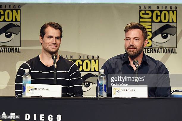 """Actors Henry Cavill and Ben Affleck from """"Batman v. Superman: Dawn of Justice"""" attend the Warner Bros. Presentation during Comic-Con International..."""