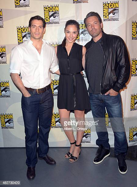 Actors Henry Cavill Gal Gadot and Ben Affleck attend the Warner Bros Pictures panel and presentation during ComicCon International 2014 at San Diego...