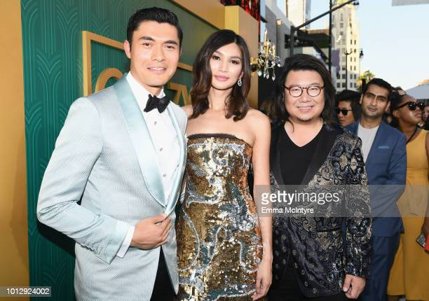 Actors Henry Golding Gemma Chan and author Kevin Kwan arrive at Warner Bros Pictures' Crazy Rich Asians Premiere at TCL Chinese Theatre IMAX on...