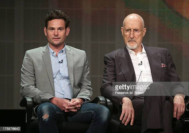 Actors Henry Thomas and James Cromwell speak onstage during the 'Betrayal' panel discussion at the Disney/ABC Television Group portion of the...