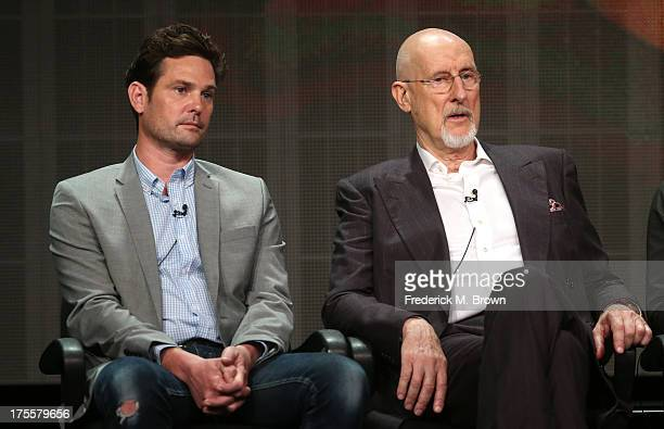 Actors Henry Thomas and James Cromwell speak onstage during the Betrayal panel discussion at the Disney/ABC Television Group portion of the...
