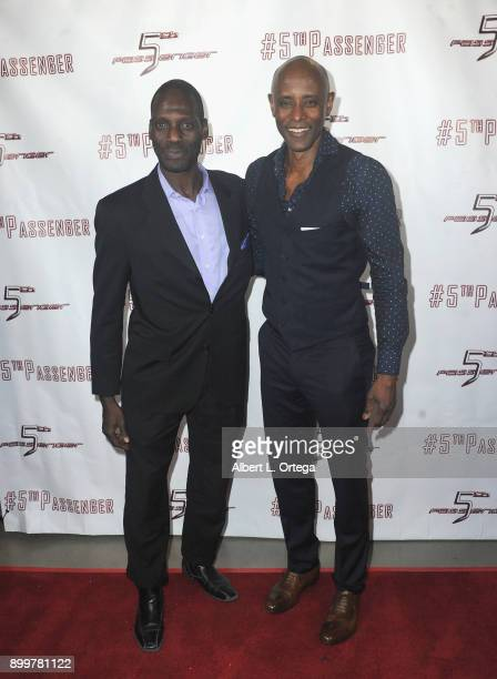 Actors Herman Wilkins and Brian Keith Gamble arrive for the cast and crew screening of 5th Passenger held at TCL Chinese 6 Theatres on December 13...