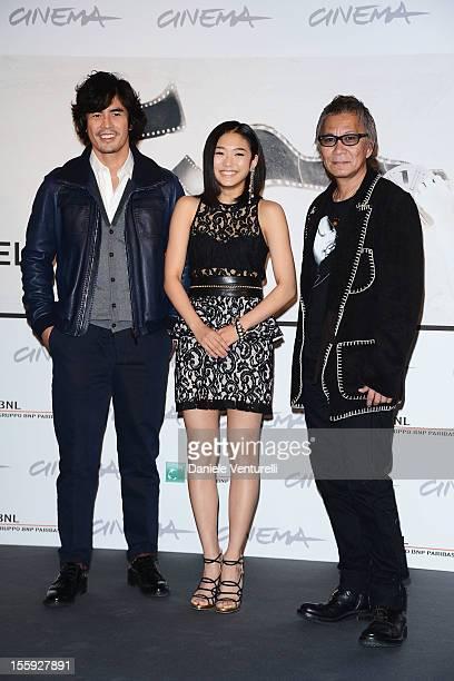 Actors Hideaki Ito Erina Mizuno and director Takashi Miike attend the 'Aku No Kyoten' Photocall during The 7th Rome Film Festival on November 9 2012...
