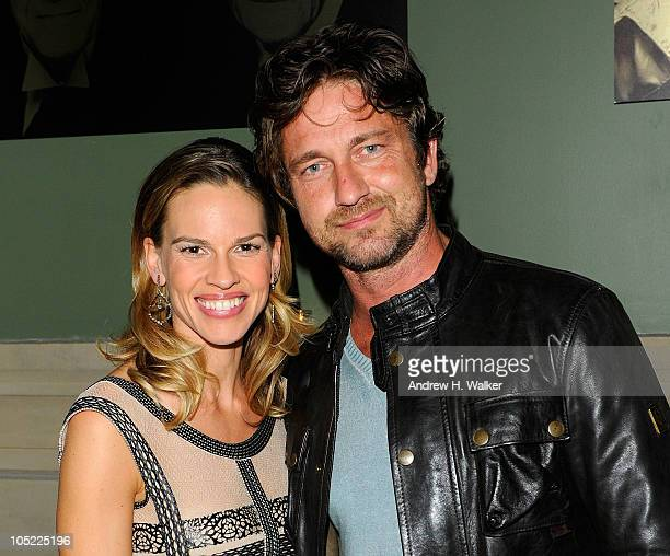 Actors Hilary Swank and Gerard Butler attends the after party for the Cinema Society screening of 'Conviction' at the Soho Grand Hotel on October 12...