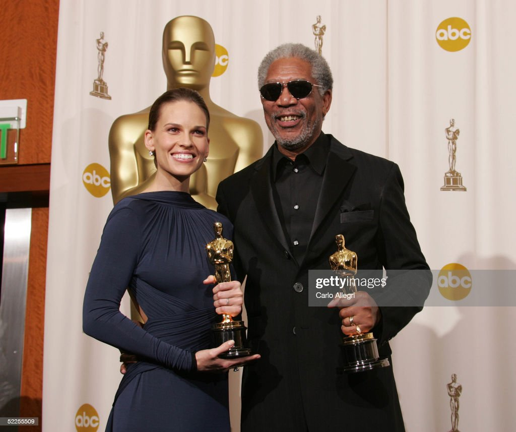 Actors Hilary Swank and Morgan Freeman pose with their 'Best Actors in a Leading Role' award for 'Million Dollar Baby' backstage during the 77th Annual Academy Awards on February 27, 2005 at the Kodak Theater in Hollywood, California.
