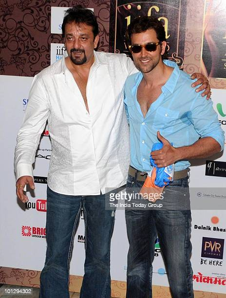 Actors Hrithik Roshan and Sanjay Dutt pose for the photographers for the forthcoming IIFA weekend and awards in Mumbai on Saturday May 29 2010