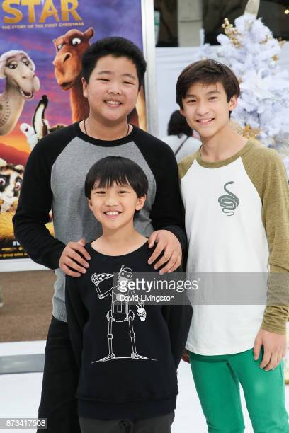 Actors Hudson Yang Ian Chen and Forrest Wheeler arrive at the Premiere of Columbia Pictures' 'The Star' at the Regency Village Theatre on November 12...