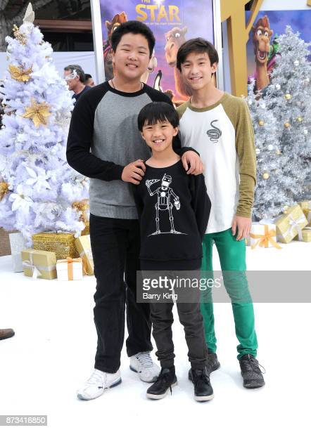 Actors Hudson Yang Ian Chen and Forrest Wheeler attend the premiere of Columbia Pictures' 'The Star' at Regency Village Theatre on November 12 2017...
