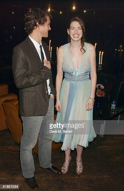 Actors Hugh Dancy and Anne Hathaway attend the 'Ella Enchanted' movie afterparty at the Rouge club on December 11 2004 in London