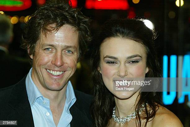 "Actors Hugh Grant and Keira Knightley attend the UK charity film premiere of ""Love Actually"" at The Odeon Leicester Square on November 16, 2003 in..."