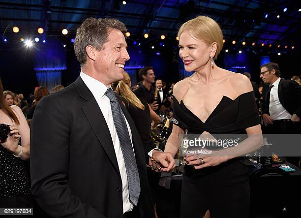 Actors Hugh Grant and Nicole Kidman attend The 22nd Annual Critics' Choice Awards at Barker Hangar on December 11, 2016 in Santa Monica, California.