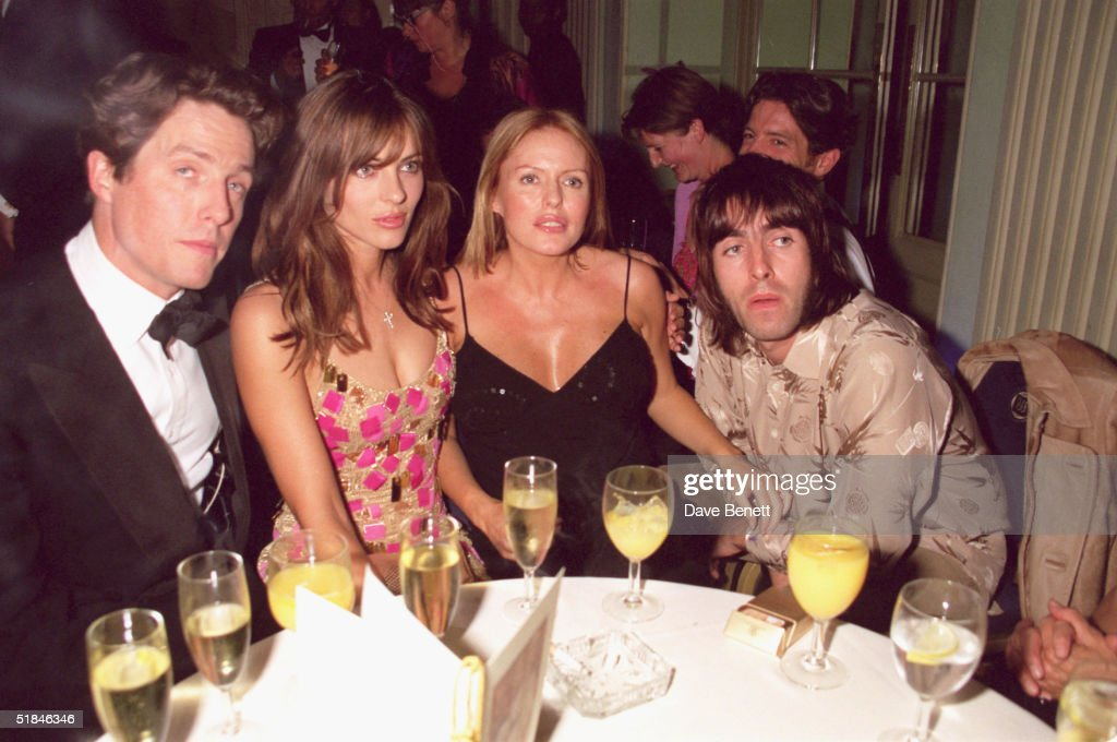 Actors Hugh Grant, Elizabeth Hurley, Patsy Kensit and Oasis lead singer Liam Gallagher attend the premiere of 'Mickey Blue Eyes' after party on August 11, 1999 in London.