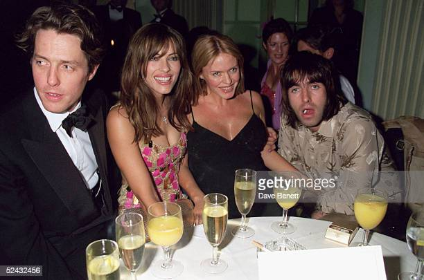 Actors Hugh Grant Elizabeth Hurley Patsy Kensit and Oasis lead singer Liam Gallagher attend the premiere of 'Mickey Blue Eyes' after party on August...